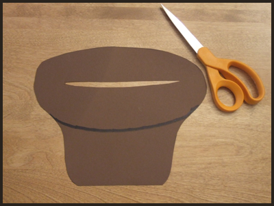Cut Out a Hole in the Easter Basket Craft for the Easter Eggs to Go