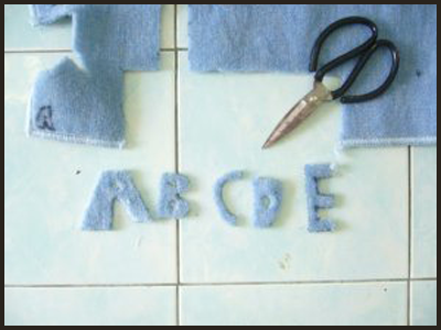 Now cut the alphabet letters out of the felt for Alphabet Letters Tactile Guessing Game Craft