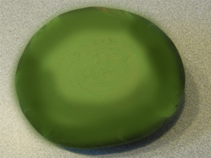 Paint the entire rock green with the green paint.