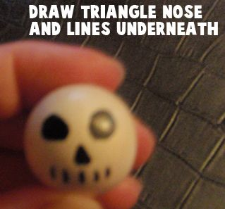 Draw a triangle nose and lines underneath