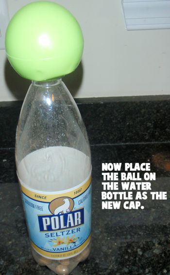 Now, place the ball on the water bottle as the new cap