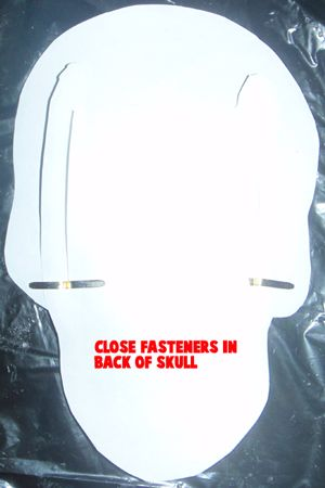 Close fasteners in back of skull