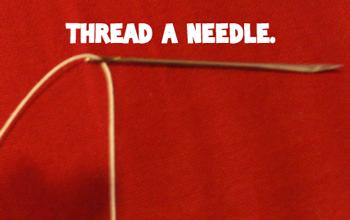Thread a needle.