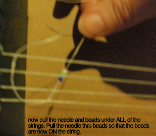 Now pull the needle and beads under ALL of the strings.