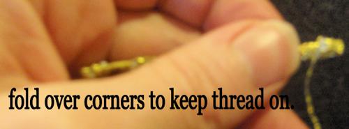 Fold over corners to keep thread on.