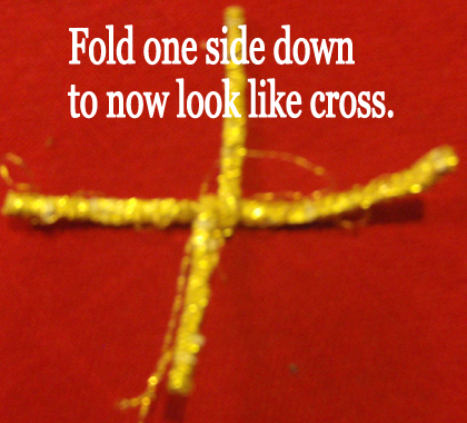 Fold one side down to now look like a cross.