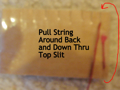 Pull string around back and down thru top slit.