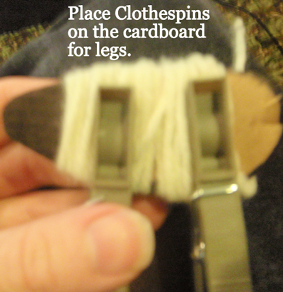 Place clothespins on the cardboard for legs.