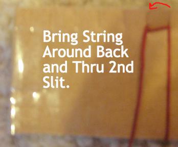 Bring string around back and thru second slit.