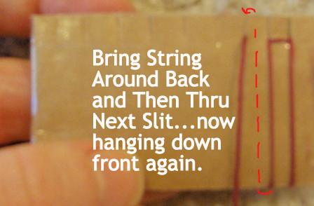 Bring string around back and then thru next slit