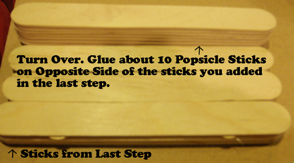 Glue about 10 Popsicle sticks on opposite side of the sticks you added in the last step.