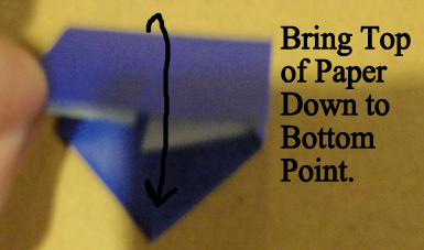 Bring top of paper down to bottom point.