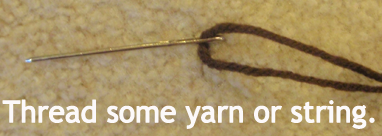 Thread some yarn or string.
