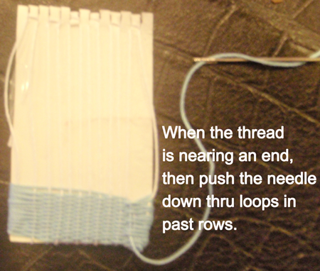When the thread is nearing the end, then push the needle down thru loops in past row.