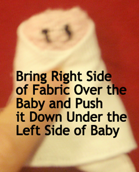 Bring right side of fabric over the baby