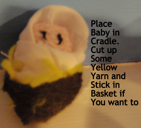 Place baby in cradle.