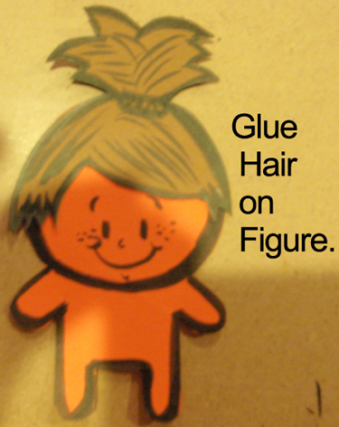 Glue hair on figure.