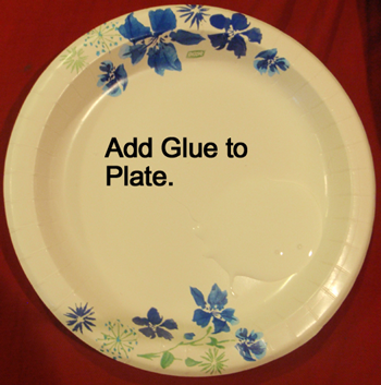 Add glue to a paper plate.