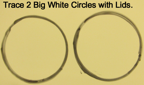 Trace 2 big white circles with lids.