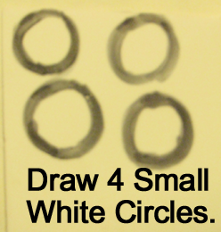 Draw 4 small white circles.