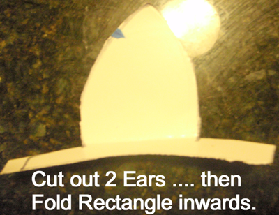 Cut out two ears... then fold rectangle inwards.