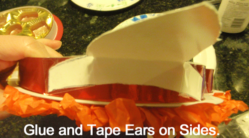 Glue and tape ears on sides.