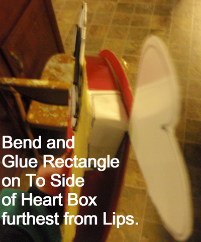 Bend and glue rectangle on to side of heart box furthest from lips.