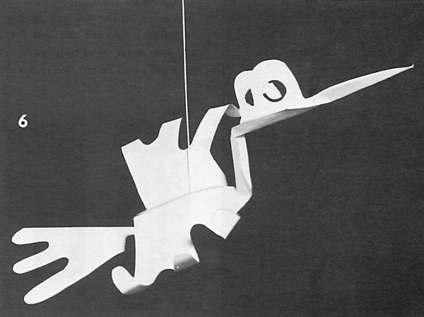 In Figure 6 another pleat is made at the neck; and the bird is suspended from the ceiling with thread.