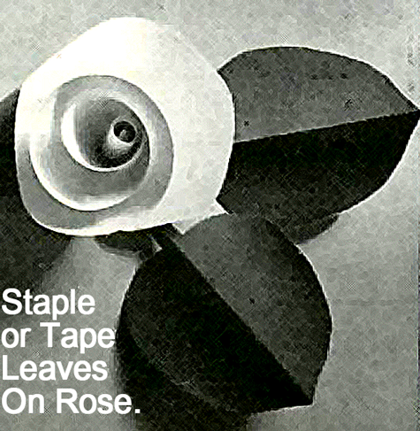 Staple or tape leaves on rose.