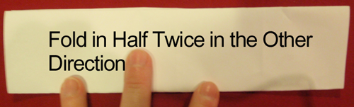 Fold in half twice in the other direction.