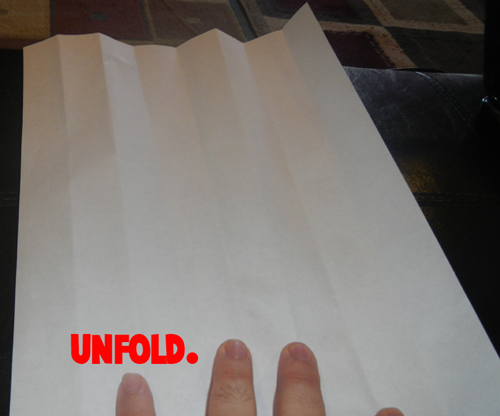Unfold the paper.