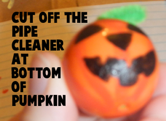 Cut off the pipe cleaner at bottom of pumpkin