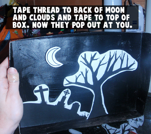 Tape thread to back of moon and clouds and tape to top of box.