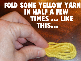 Fold some yellow yarn in half a few times