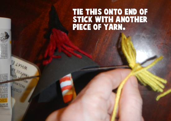 Tie this on to end of stick with another piece of yarn.