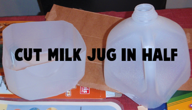 Cut milk jug in half.