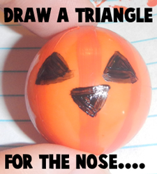 Draw a triangle for the nose.