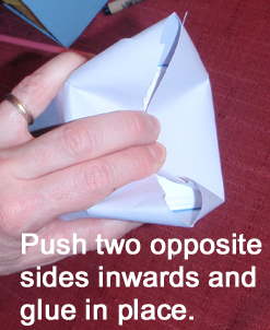 Push two opposite sides inwards and glue in place.
