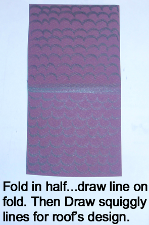 Fold in half.... draw line on fold.  Then draw squiggly lines for roof's design.