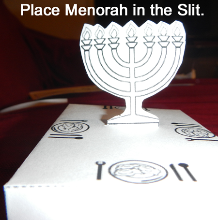 Place menorah in the slit.