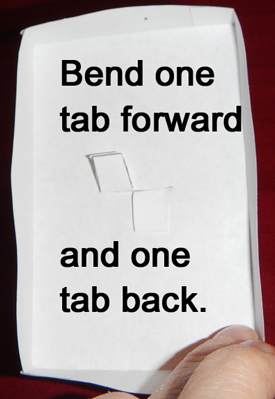 Bend one tab forward and one tab back.