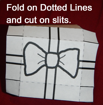 Fold on dotted lines and cut on slits.