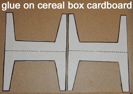 Glue on cereal box cardboard.