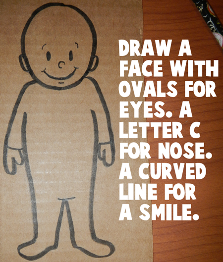 Draw a face on the doll.