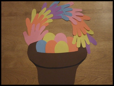 Easter basket hand print craft preschool education for kids this is a really cute easter egg basket from paper with hand prints for a handle it could be a simple class project for a bulletin board display negle Choice Image