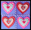Hanging Hearts Cut-Paper Quilt