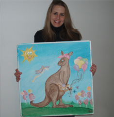 Jessica Rachlin Holding Up her Hand-Painted Donated Canvas Mural for the Pediatric ER - Great Volunteer