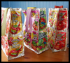 <strong>Recycled Juice Pouch Lunch Bag Craft for Kids</strong>