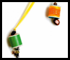 Old-Spool   Charm on a Necklaces    : Crafts with  Wooden Spools