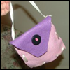 The Handbag Addiction Starts Early With a Felt Purse